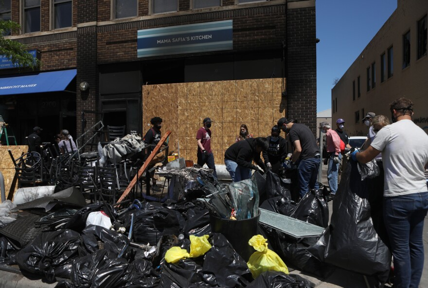 Dozens of volunteers from across Minneapolis came to help clear debris from Mama Safia's Kitchen.