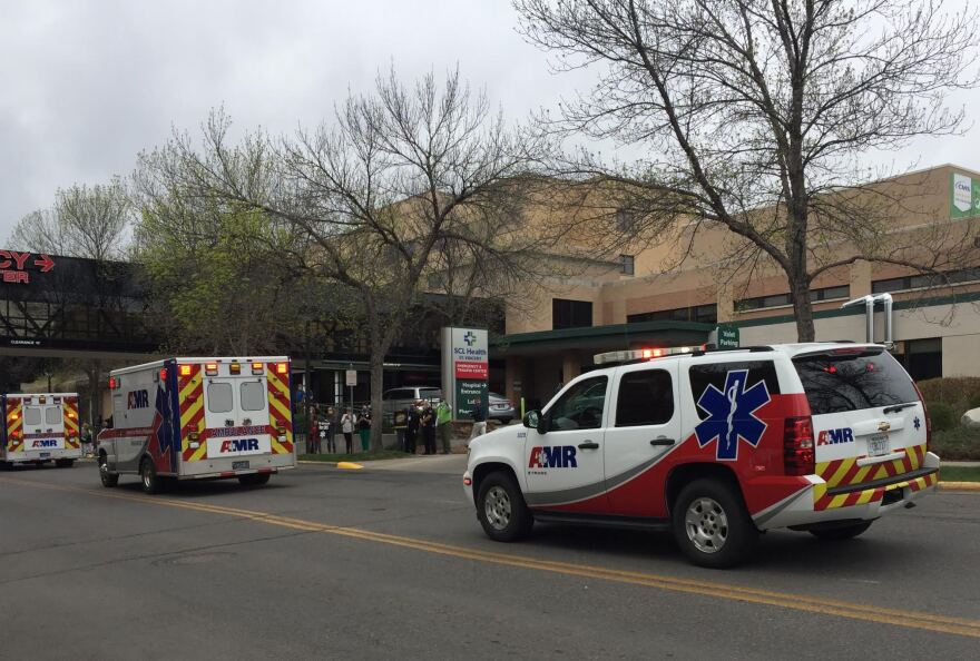 A motocade drives by Billings' two hospitals on May 6, 2020.