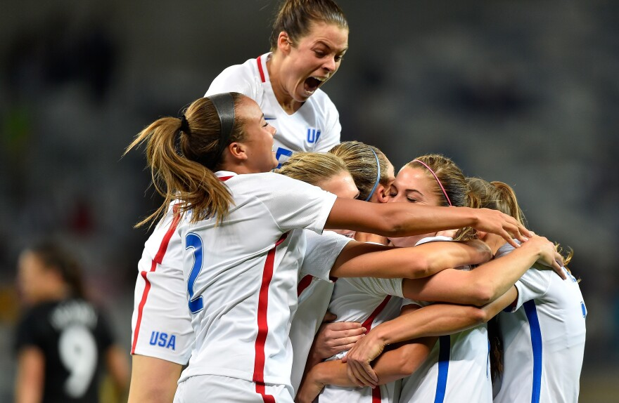 Kelley O'Hara (top) joins her American teammates in celebrating a second-half goal by Alex Morgan in the U.S. women's soccer team's Group G first-round win over New Zealand in Belo Horizonte, Brazil, on Wednesday.