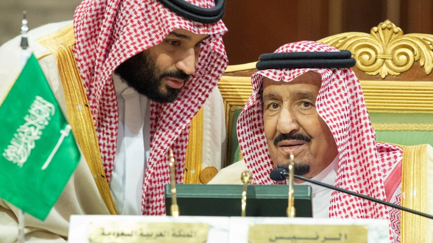 Saudi Crown Prince Mohammed bin Salman (left) talks with King Salman bin Abdul-Aziz Al Saud during the Gulf Cooperation Council summit in Riyadh, Saudi Arabia, on Dec. 9.