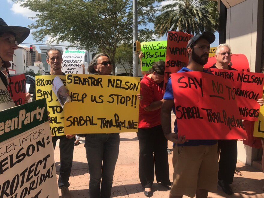 Protesters outside Sen. Bill Nelson's office in Coral Gables on Tuesday demanded a response to their petition against the Sabal Trail Pipeline.