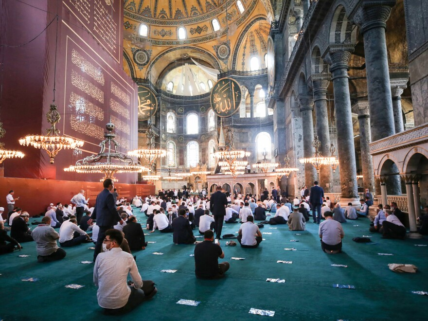 People gather to perform Friday Prayer in the Hagia Sophia for the first time after 86 years in Istanbul, Turkey.