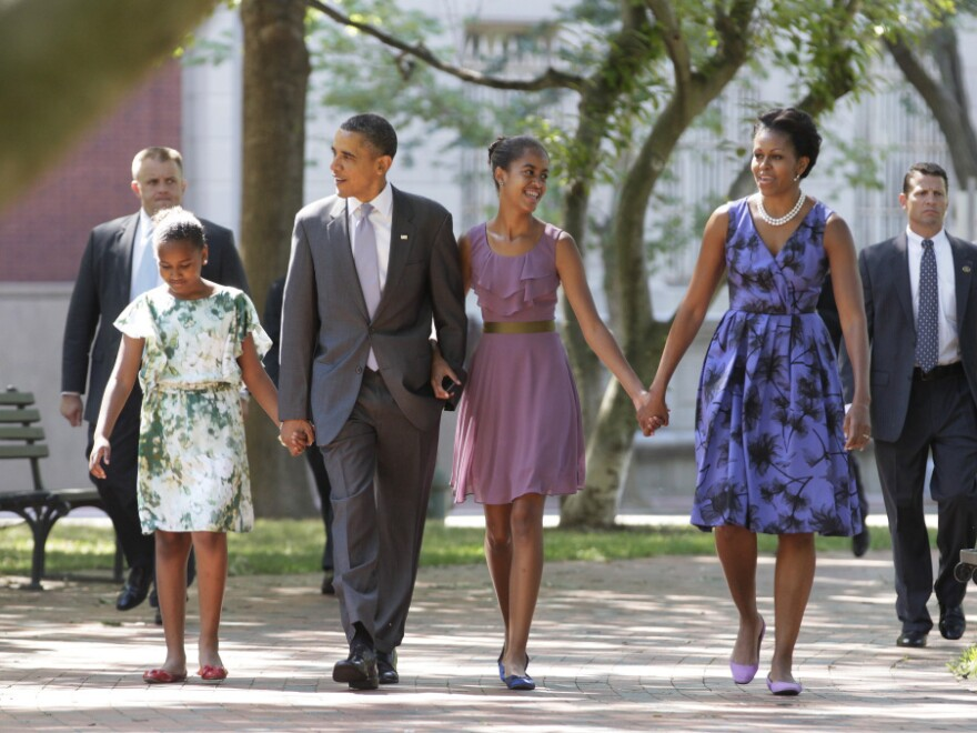 President Barack Obama walks with First Lady Michelle Obama and their daughters Malia and Sasha to St. John's Church Sunday, July 17, 2011, in Washington.