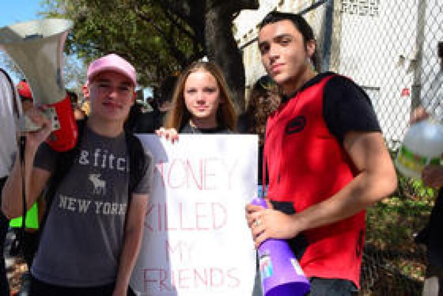 Samuel Abello (left), Sophia Villiers-Fuerze (center), and Isaiah Elijo (right) participated in the protest at South Broward High School