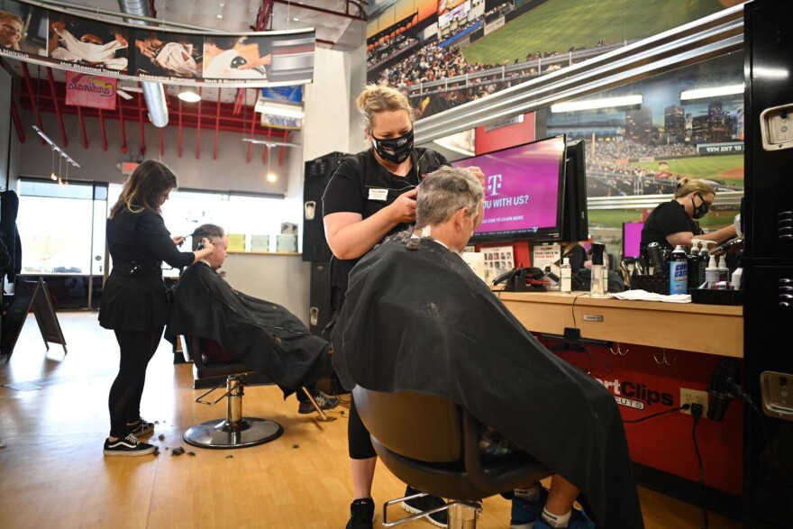 Sport Clips Haircuts in Ballwin was among the businesses in St. Louis and St. Louis County that reopened Monday. Phone lines were tied up at the salon and by the afternoon its website showed wait times longer than two hours.