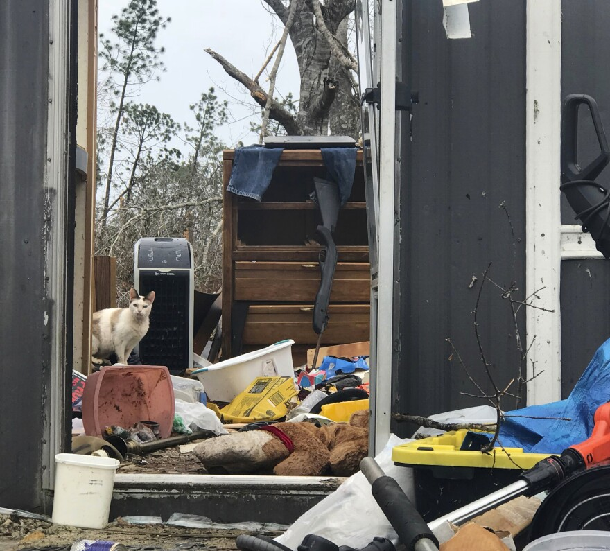 Mark Ward surveys the destruction of his neighbor's mobile home in Bay County, Fla. Ward and his neighbors say that the rural parts of the county have seen little help since Hurricane Michael.