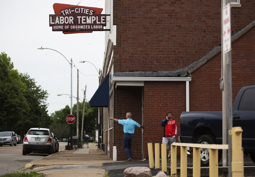 Local 1899 members enter the labor temple before the start of a union meeting in Granite City. May 2018