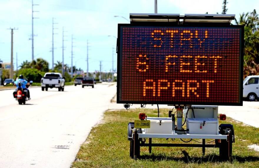 6_feet_sign_marathon_3.21.20_charles_trainor_jr_0.jpg