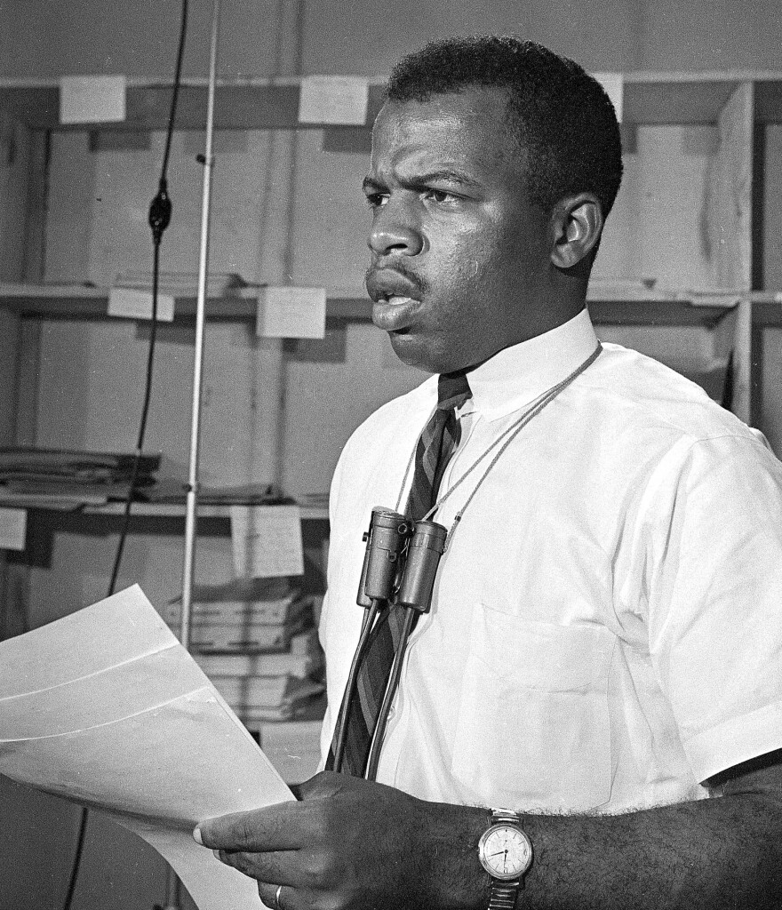 Civil rights leader John Lewis speaks during a news conference in Jackson, Miss., on June 23, 1964.