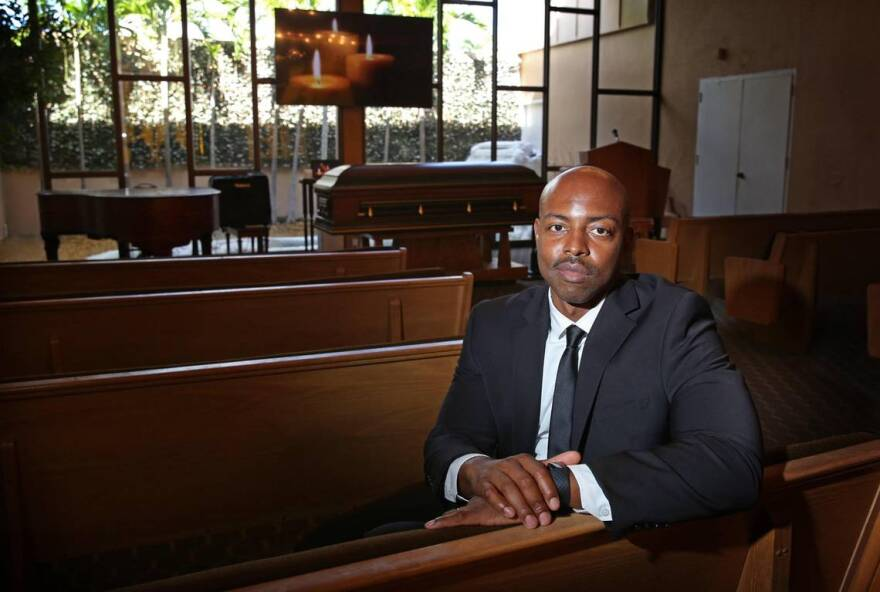 Evans St. Fort, CEO of the family-owned and operated St. Fort's Funeral Home & Cremation in North Miami Beach, stands in the chapel Monday morning, August 10, 2020. The funeral home has seen a 30 percent increase in its business due to COVID-19 related deaths, which are hitting South Florida's Haitian-American community especially hard.
