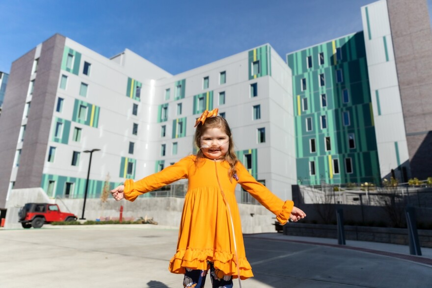 A patient stands in front of Ronald McDonald House's newest space in Cincinnati.