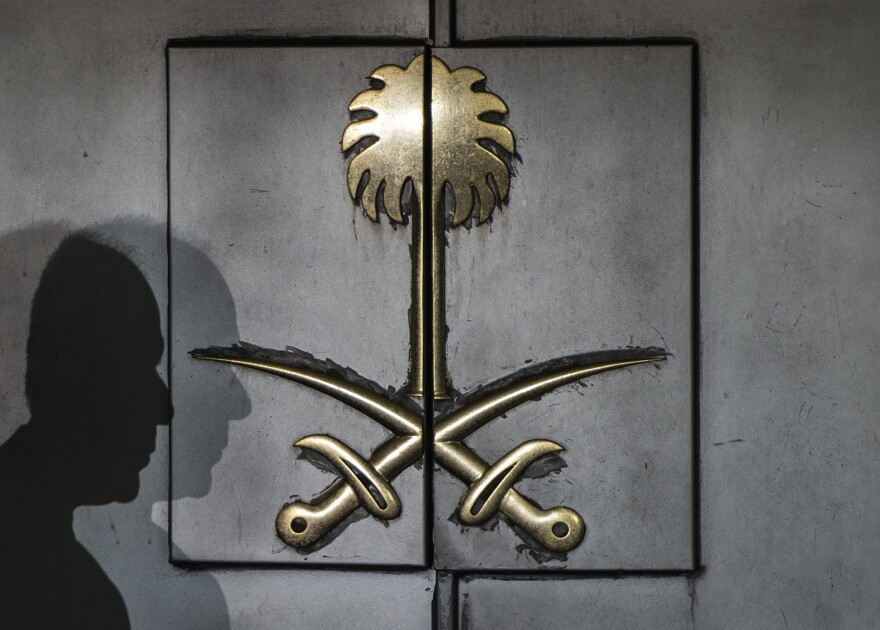 The shadow of a security guard rests atop the front door of the Saudi consulate Friday in Istanbul. Journalist Jamal Khashoggi vanished after visiting the building earlier this month, and simmering international suspicion puts the Saudi government behind his murder.