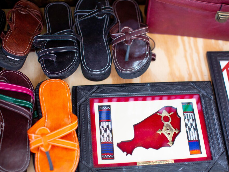 Leather sandals, made by Saley, on display along with other items.