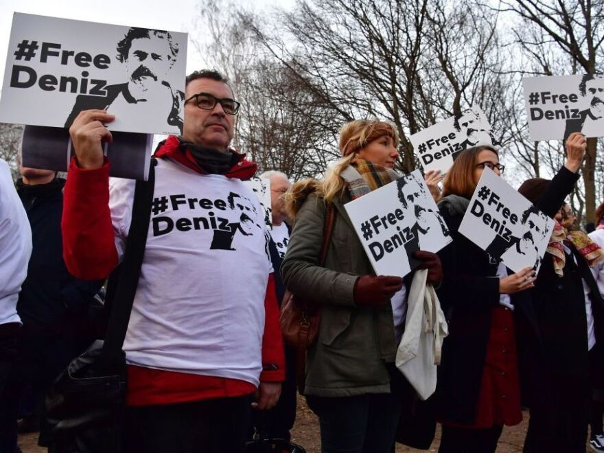 People hold placards with hashtag #FREEDENIZ to protest the detention of German journalist Deniz Yucel in front of Turkish embassy in Berlin on Feb. 28, 2017.