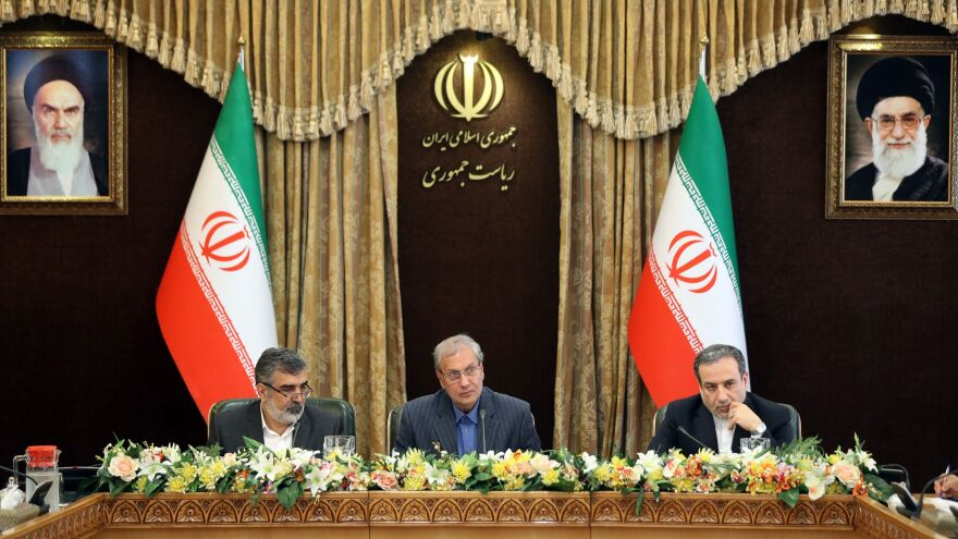 From left: Iran's Atomic Energy Organization spokesman Behrouz Kamalvandi, government spokesman Ali Rabiei and Deputy Foreign Minister Abbas Araghchi give a joint press conference at the presidential headquarters in the capital Tehran on Sunday. Iran is enriching uranium beyond a 3.67% cap set by the nuclear deal.