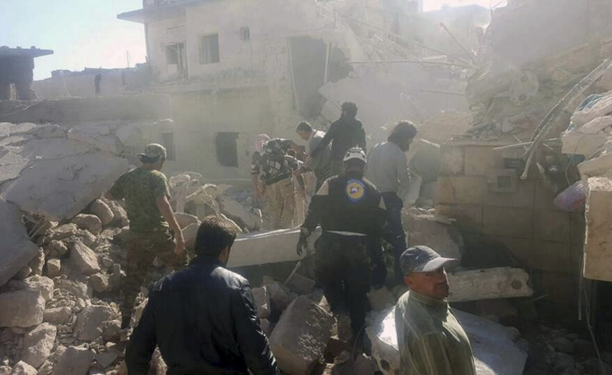 Civil Defense workers and Syrian citizens inspect damaged buildings after airstrikes hit earlier this month in Darat Izza, western Aleppo province, Syria. Airstrikes had halted in eastern Aleppo but have now resumed.