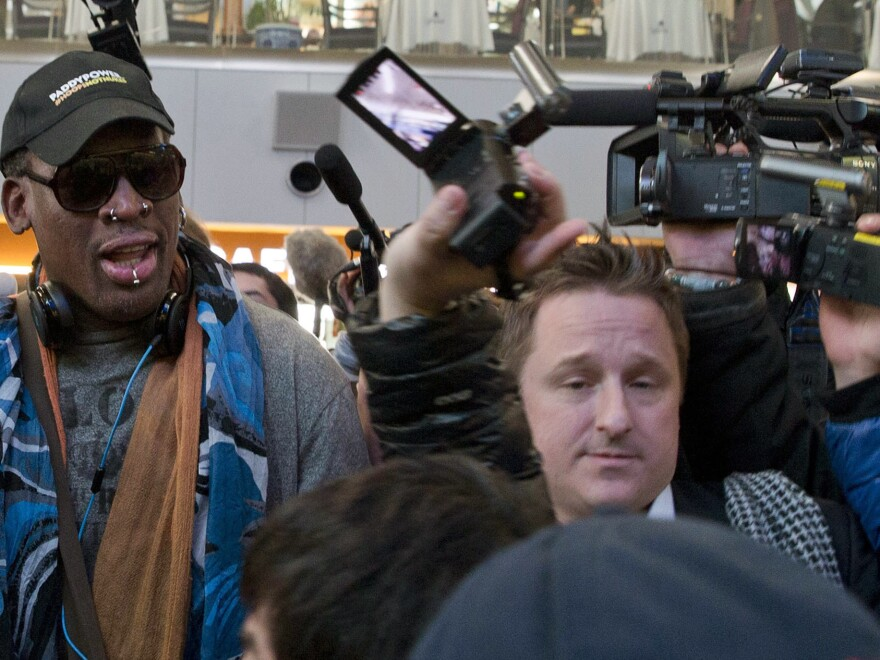 Michael Spavor is seen in 2013 with former NBA star Dennis Rodman, on arrival at the Beijing airport for a flight to North Korea. Spavor is the second Canadian man to be detained by China this week, in what appears to be retaliation for Canada's arrest of a top executive of telecommunications giant Huawei.