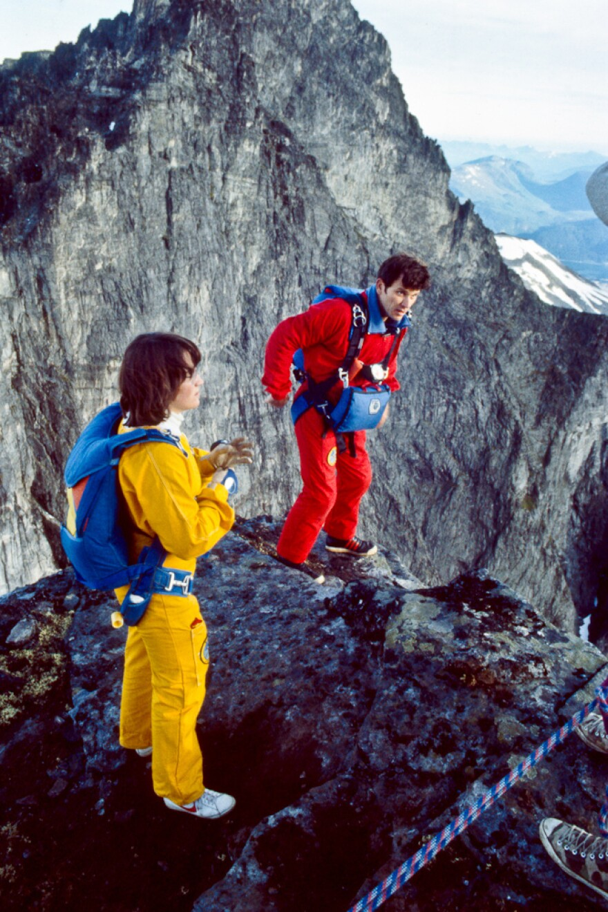 Jean and Carl Boenish standing on a ledge preparing to jump.