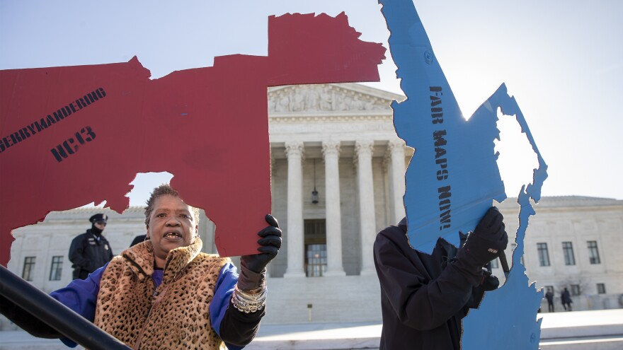 Activists at the Supreme Court opposed to partisan gerrymandering hold up representations of congressional districts from North Carolina (left) and Maryland on March 26. On June 27, justices decided that the practice is beyond the reach of federal courts.