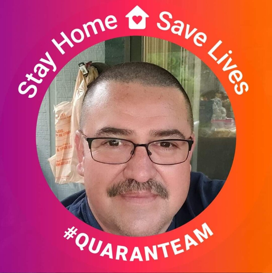 "A photo of Ernesto Torres with a ""Stay Home Save Lives"" filter."
