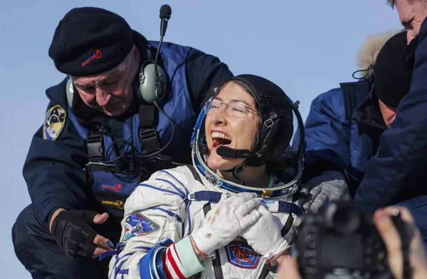 U.S. astronaut Christina Koch reacts shortly after the landing of the Russian Soyuz MS-13 space capsule about 150 km south-east of the Kazakh town of Zhezkazgan, Kazakhstan, Thursday, Feb. 6, 2020. (Sergei Ilnitsky/AP Photo)