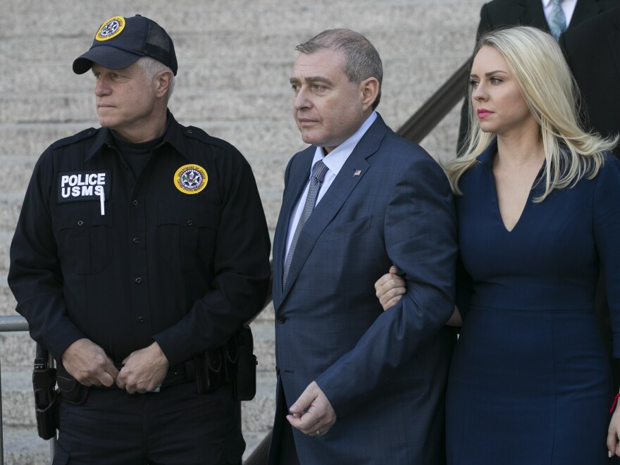 Lev Parnas (center) leaves federal court following his arraignment on Oct. 23 in New York. Parnas and Igor Fruman are charged with conspiracy to make illegal campaign contributions.