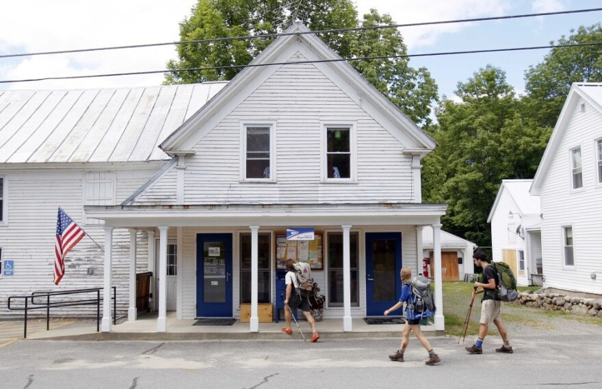 Hikers arrive at the post office in Caratunk, Maine, in 2011. Some of the rural post offices the U.S. Postal Service may close are relied on by Appalachian Trail hikers for supply drops on their trip from Georgia to Maine.