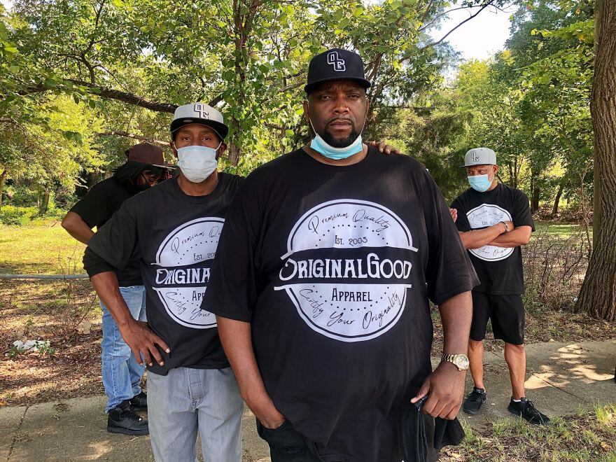 Former gang members gather at Bushman Elementary School in Dallas for a block party aimed at bringing the community together to talk about how to reduce violence in the neighborhood.
