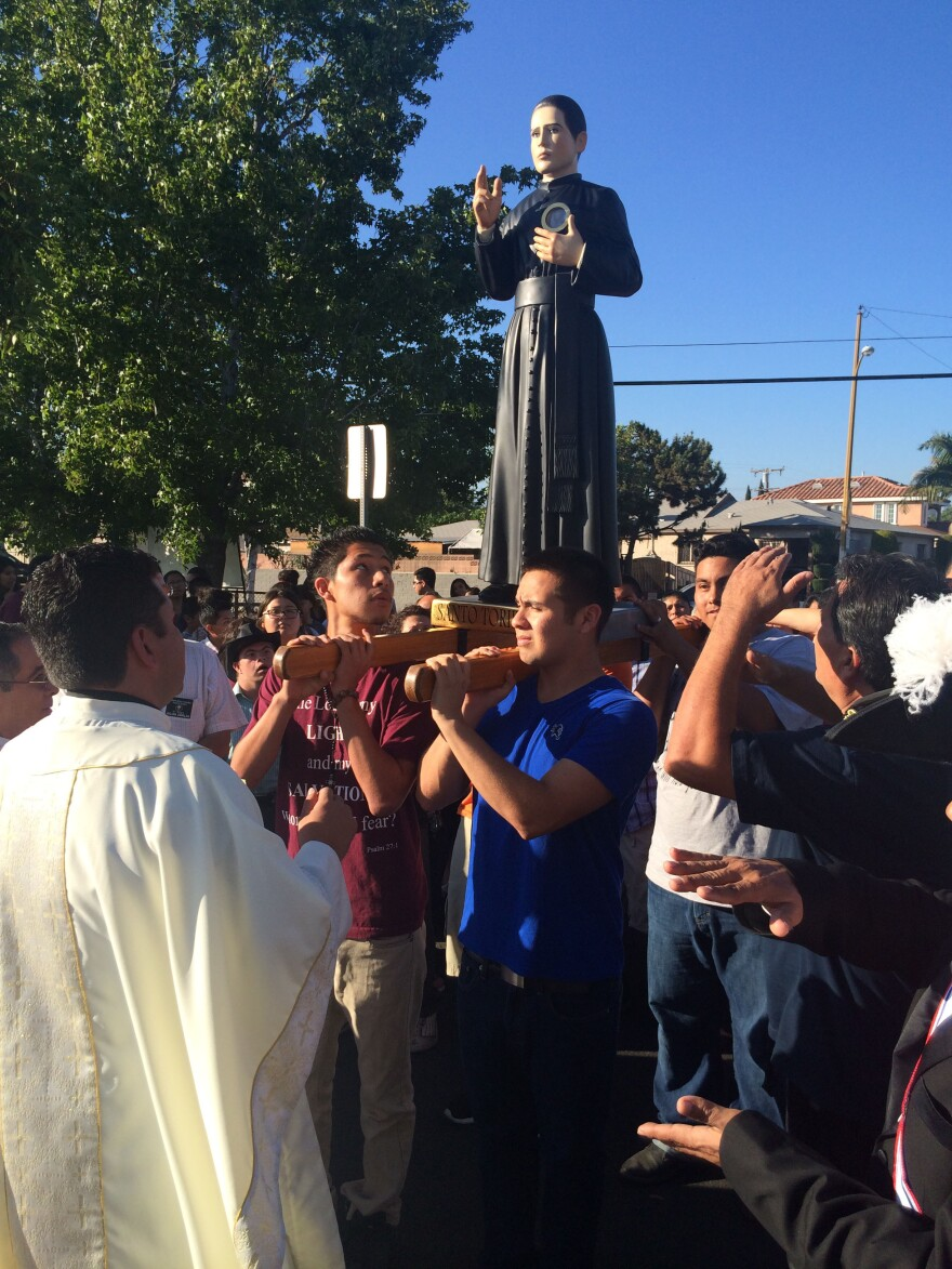 People carry the statue of St. Toribio Romo in a procession at East Los Angeles' St. Marcellinus Church.