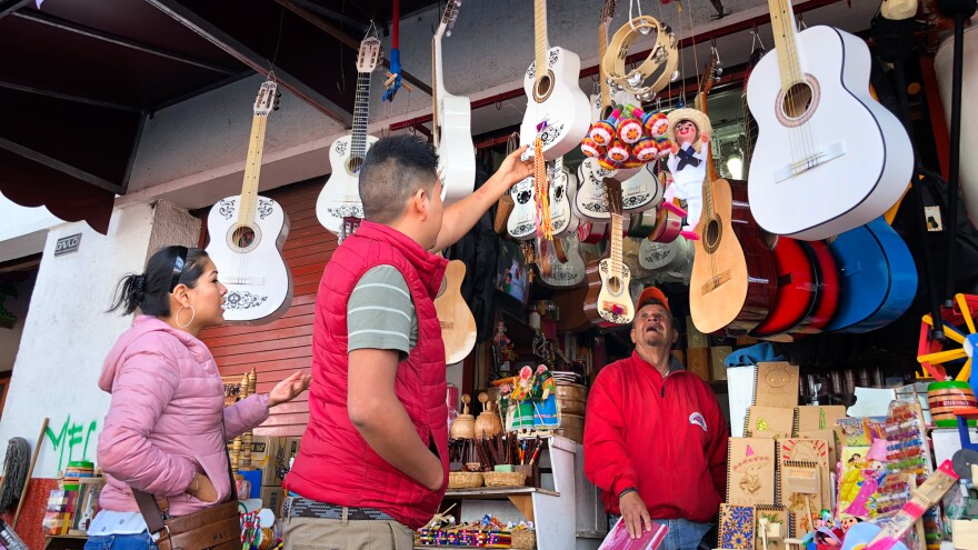"""Guitars, especially white-painted ones, in the Mexican town of Paracho are selling fast thanks to <em>Coco</em>. """"We are all <em>loco</em> for <em>Coco</em>,"""" one shopkeeper says."""