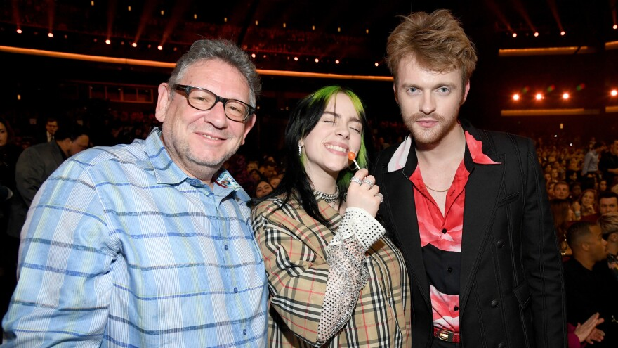From left: Lucian Grainge, CEO of Universal Music Group; artist Billie Eilish; and Eilish's brother, songwriter Finneas O'Connell — photographed during the 2019 American Music Awards at Microsoft Theater on Nov. 24, 2019 in Los Angeles.