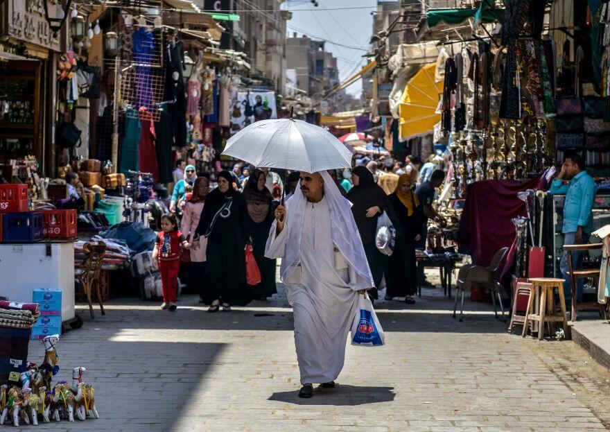 An Egyptian man walks down the street at the Khan al-Khalili market in Cairo.