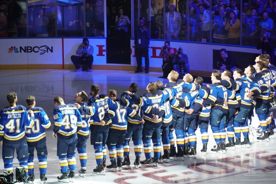 The Blues watch as the Stanley Cup championship banner is raised to the rafters at Enterprise Center.