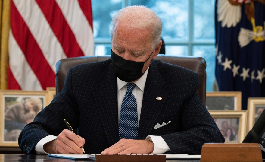 President Biden signs an executive order Monday reversing a Trump-era ban on transgender people serving in the military.