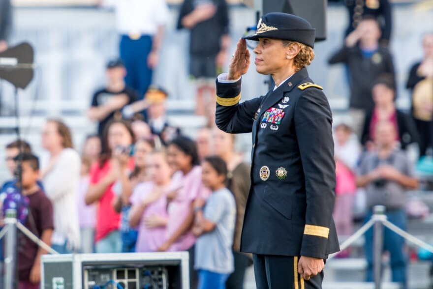 Lt. Gen. Nadja Y. West, the 44th Surgeon General of the United States Army and commanding general, U.S. Army Medical Command renders honors during a Twilight Tattoo performance, on Summerall Field, Joint Base Myer Henderson-Hall, Va., May 9, 2019.