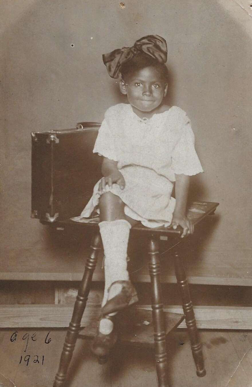 When Olivia Hooker was 6 and at home with her family in Tulsa, Okla., a group of white men came through the backyard carrying torches.