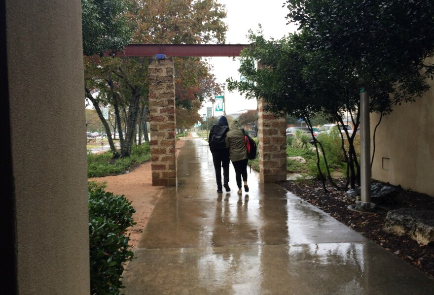 Students walk across the Palo Alto College campus on a rainy day in December 2017.