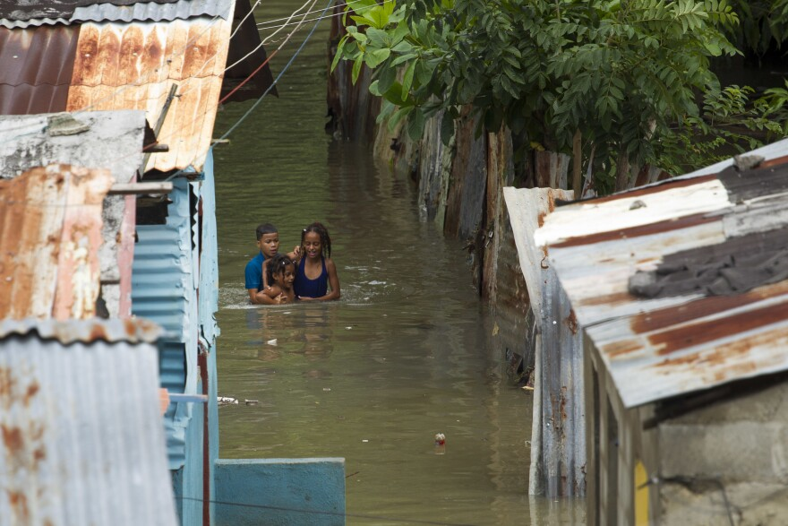Streets were inundated in a neighborhood in Santo Domingo, Dominican Republic, on Tuesday. Hurricane Matthew dumped rain across the island of Hispaniola, which is split into the Dominican Republic in the east and Haiti to the west.