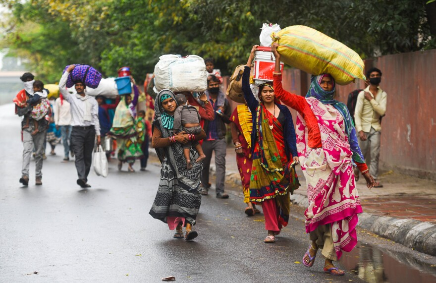 Migrant workers head home from New Delhi after the national lockdown took effect.
