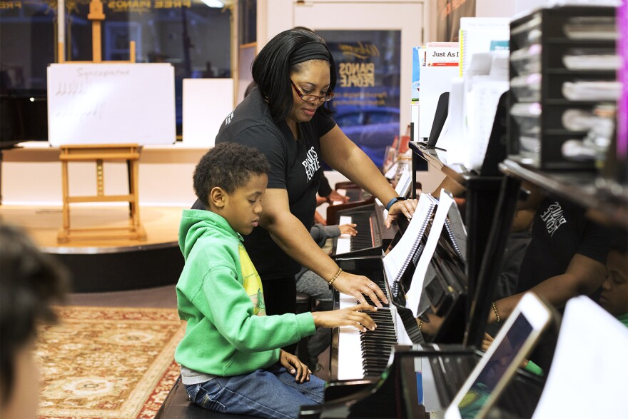 Kayia Baker leads a piano class for beginners at Pianos for People on Cherokee Street.