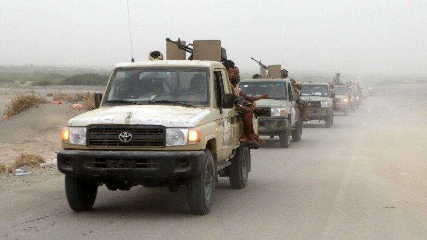A column of Yemeni pro-government forces, travels Wednesday about five miles south of Hodeidah international airport. Backed by the Saudi-led coalition, the fighters launched an offensive to retake the rebel-held Red Sea port city.