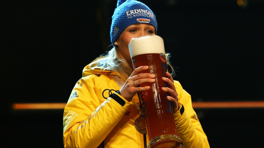 Magdalena Neuner of Germany enjoys a glass of Erdinger nonalcoholic beer after a medal ceremony at the biathlon world championships in Ruhpolding, Germany, in 2012. Today's Olympians have been swept up in a new trend largely emerging from Bavaria: nonalcoholic athletic recovery beers.
