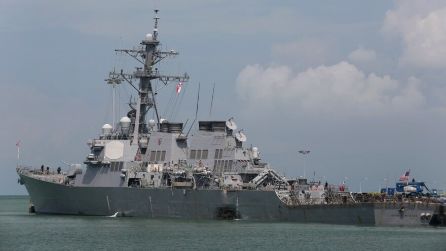 The guided-missile destroyer USS John S. McCain is moored pier side at Changi naval base in Singapore.