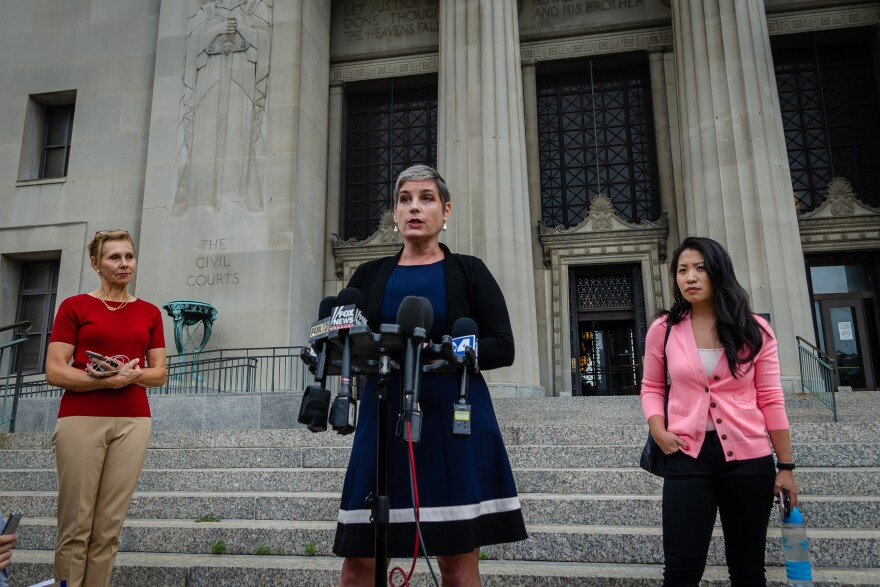 Director of Planned Parenthood Advocates in Missouri M'Evie Mead addresses reporters outside the St. Louis Circuit courthouse on Friday. June 21, 2019
