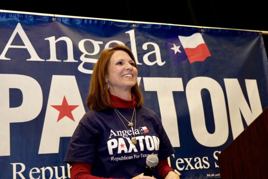 Angela Paxton celebrates victory in her state senate race on March 6, 2018.