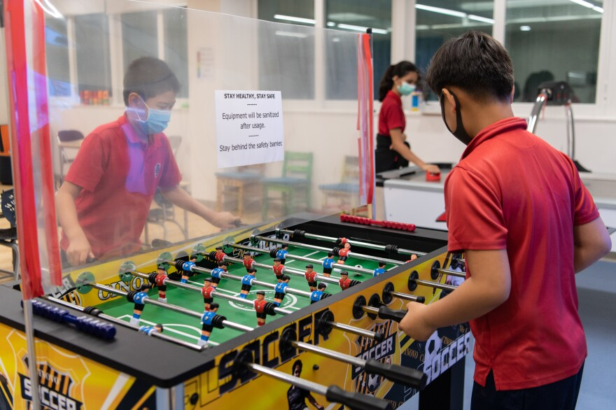 PE during a pandemic could be a game of table football with plastic dividers between players.
