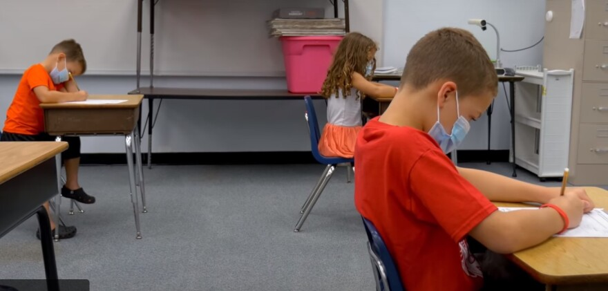 A video by Hernando County Schools shows children wearing masks with desks spaced six feet apart