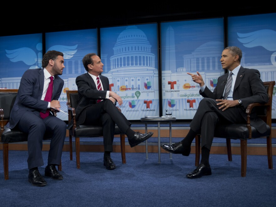 President Obama talks with television hosts Jose Diaz-Balart, center, and Enrique Acevedo, left, about the benefits of the Affordable Care Act for Latinos.