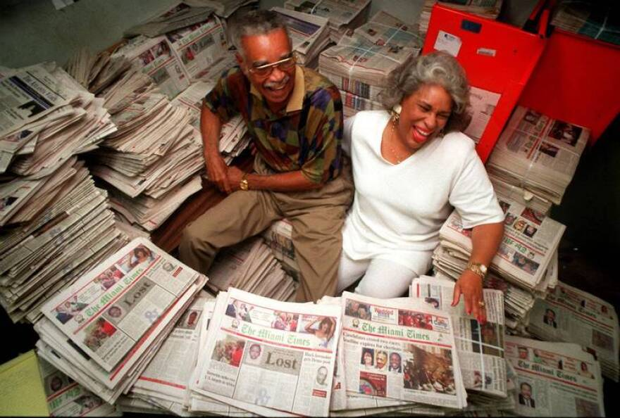 Garth C. Reeves Publisher Emeritus and his daughter Rachel Reeves surrounded by copies of The Miami Times.