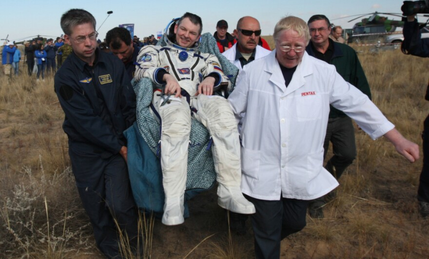 Russian space agency rescuers carry  Russian cosmonaut Alexander Samokutyayev after his landing aboard the Soyuz TMA-21 space capsule.